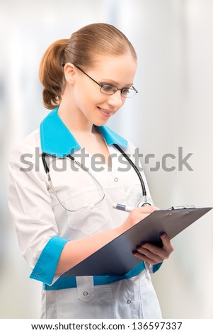 friendly woman doctor with a folder writes medical history