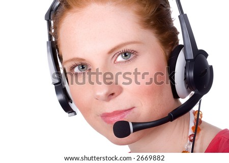 Friendly woman smiling with headset. Looking straight into the camera. Isolated on white.