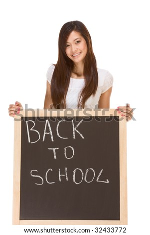 Friendly young ethnic High school girl of mixed Vietnamese and Chinese race student standing by chalkboard
