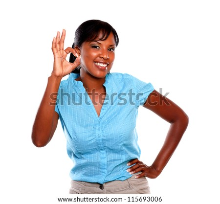 Friendly young female saying great job on blue shirt against white background
