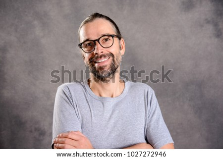 friendly young man smiling in to the camera - Shutterstock ID 1027272946