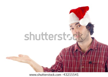 Friendly young man with Christmas hat holding an imaginary product, isolated over white background