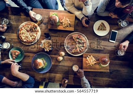 Friends all together at restaurant having meal stock photo