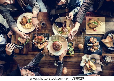 Friends all together at restaurant having meal