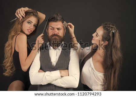 Friends at hairdresser salon. People make haircut, love relations, friendship. Bearded man, sexy women with long hair. Women with comb, scissors cut hair. Barbershop, fashion, beauty, hipster #1120794293