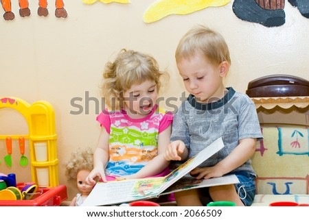 Friends. Boy and girl read book.