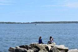 Friends by the shore in Portland, Maine