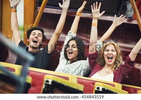 Friends Carnival Ride Fun Hands Raised Concept