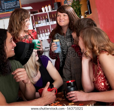 Friends catching up with each other at a cafe