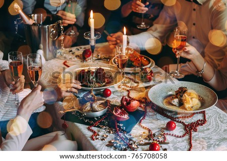 Friends celebrating Christmas or New Year eve. Party table with rose champagne. #765708058