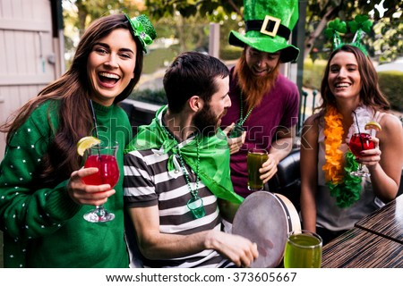 Friends celebrating St Patricks day with drinks in a bar