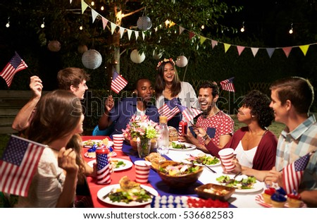 Friends Celebrating 4th Of July Holiday With Backyard Party #536682583