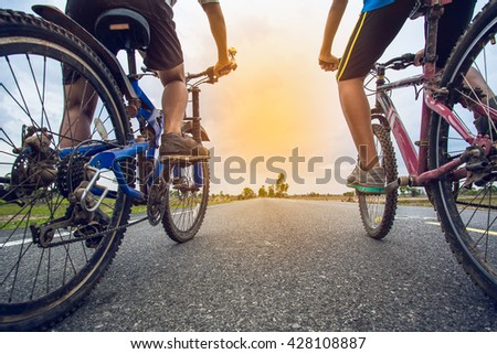Friends cycling together