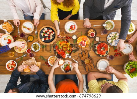 Friends dinner table top view. People eat healthy food together, home party #674798629