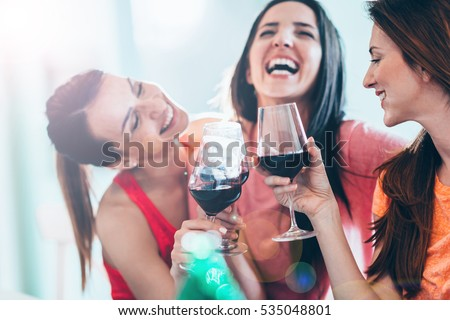 friends drinking wine in...