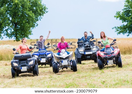 Friends driving off-road with quad bike or ATV Stock photo ©