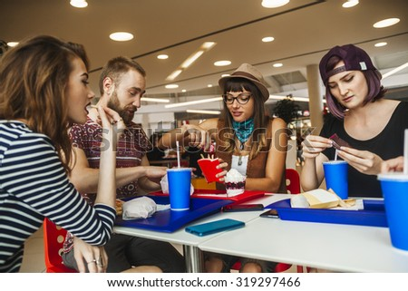 Friends Eating Fast Food At The Mall #319297466