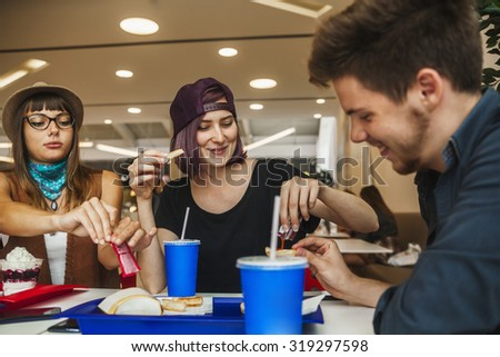 Friends Eating Fast Food At The Mall #319297598