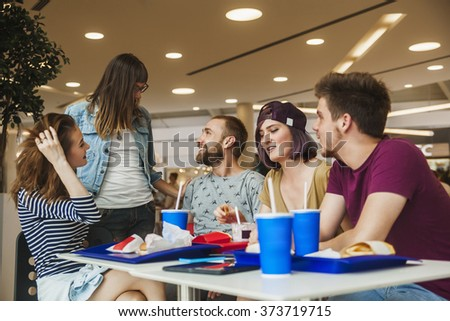 Friends Eating Fast Food At The Mall #373719715