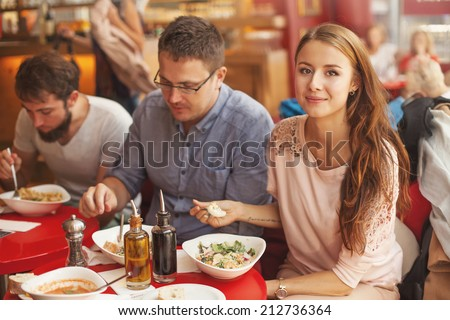 friends eating together focus on a woman