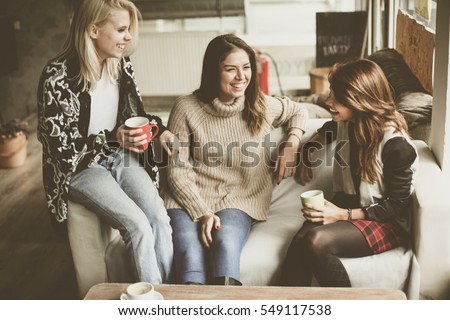 Friends enjoying  in conversation and drinking coffee. #549117538