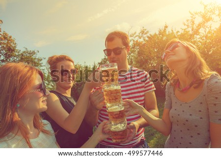 Friends enjoying outdoors with the beer. #499577446