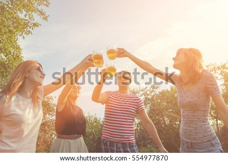 Friends enjoying outdoors with the beer.