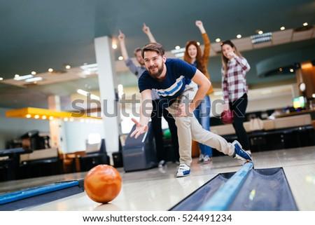 Friends enjoying recreational  bowling at club #524491234