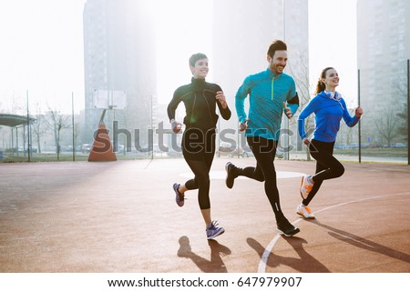 Friends fitness training together outdoors living active healthy stock photo