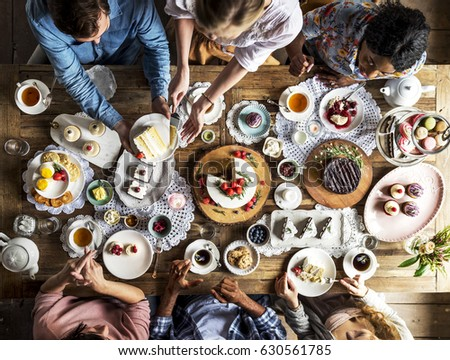 Friends Gathering Together on Tea Party Eating Cakes Enjoyment happiness #630561785