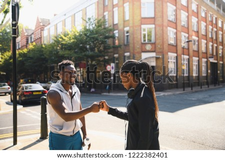 Friends giving a fist bump in London #1222382401