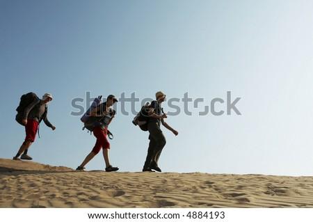 Friends going up along hill in mountain - Shutterstock ID 4884193