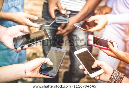 Friends group having addicted fun together using smartphones - Hands detail sharing content on social network with mobile smart phone - Technology concept with people millennials online with cellphone
