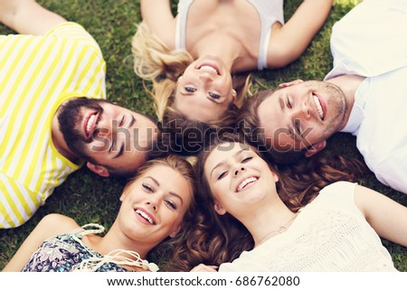 Friends group having fun together on grass #686762080