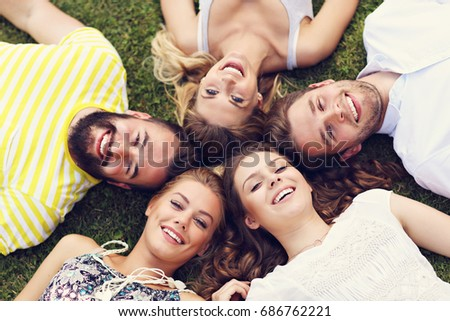 Friends group having fun together on grass #686762221