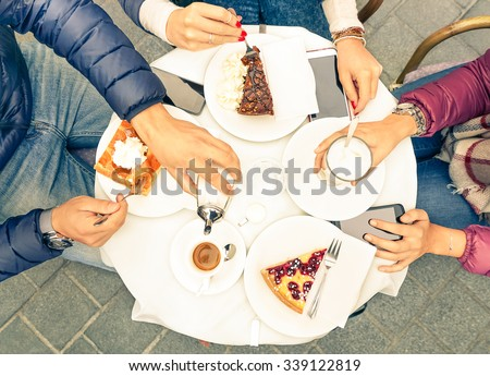 Friends group with cakes coffee and milk at bar restaurant - Close up of people hands with smartphones with upper point of view - Technology concept with addicted men and women - Warm vintage filter