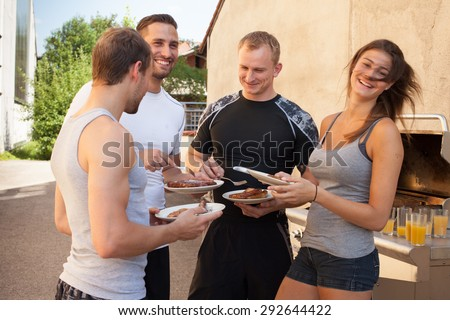Friends having a barbecue after fitness work out