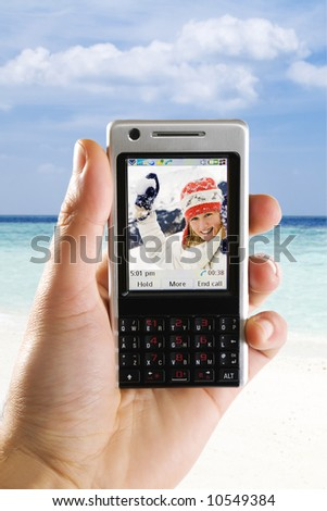 friends having a video conference with a umts mobile phone. You can change the picture on the phone as you like