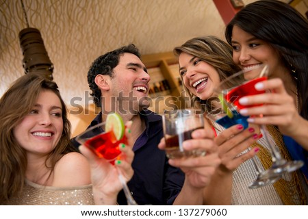 Friends having drinks at the club looking very happy