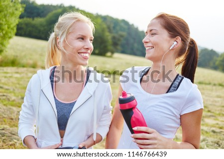 Friends having fun and making sport together and drinking water #1146766439