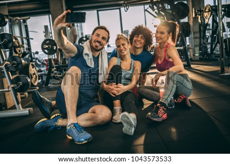 Friends having fun at the gym. Making a selfie photo.