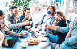 Friends having fun drinking and eating at coffeehouse - Young people talking together at restaurant cafeteria - New normal lifestyle concept with happy men and women at cafe bar - Bright azure filter