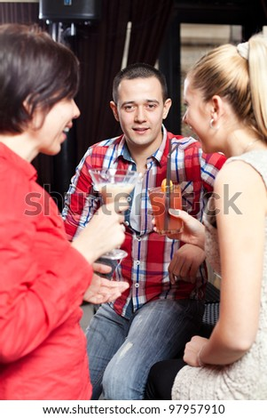 Friends having fun in a bar - stock photo