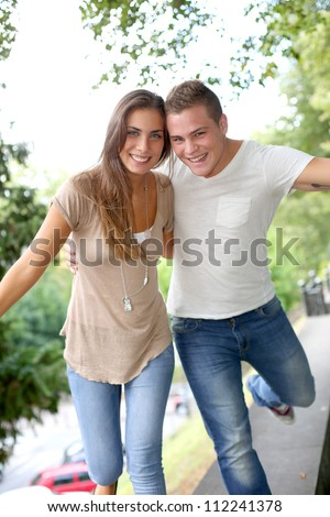 Friends having fun out in the street