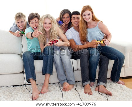 friends having fun playing video games in the living room stock photo 41709976 shutterstock. Black Bedroom Furniture Sets. Home Design Ideas