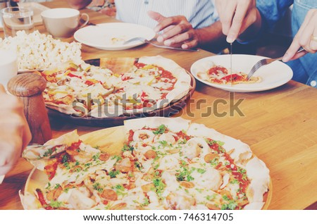 Friends having lunch or dinner at pizza restaurant, selected focus. Friends enjoy party or  meeting #746314705