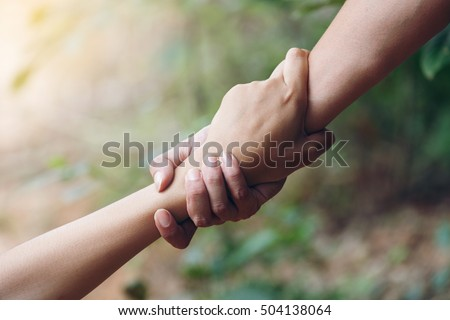 friends holding hands pulled...