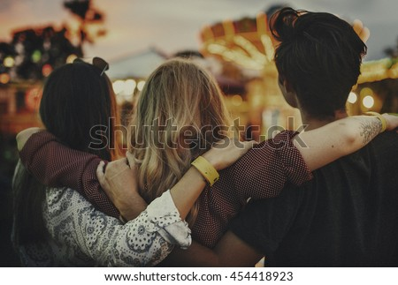 Friends Huddle Happiness Amusement Park Festival Concept #454418923
