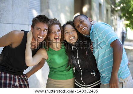 friends hugging and laughing
