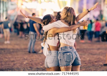 Friends hugging on music festival